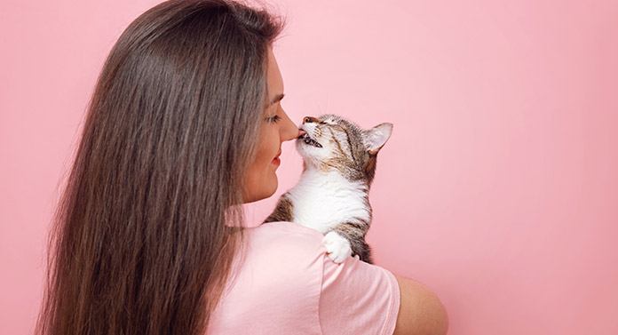 what does it mean when a cat licks your nose